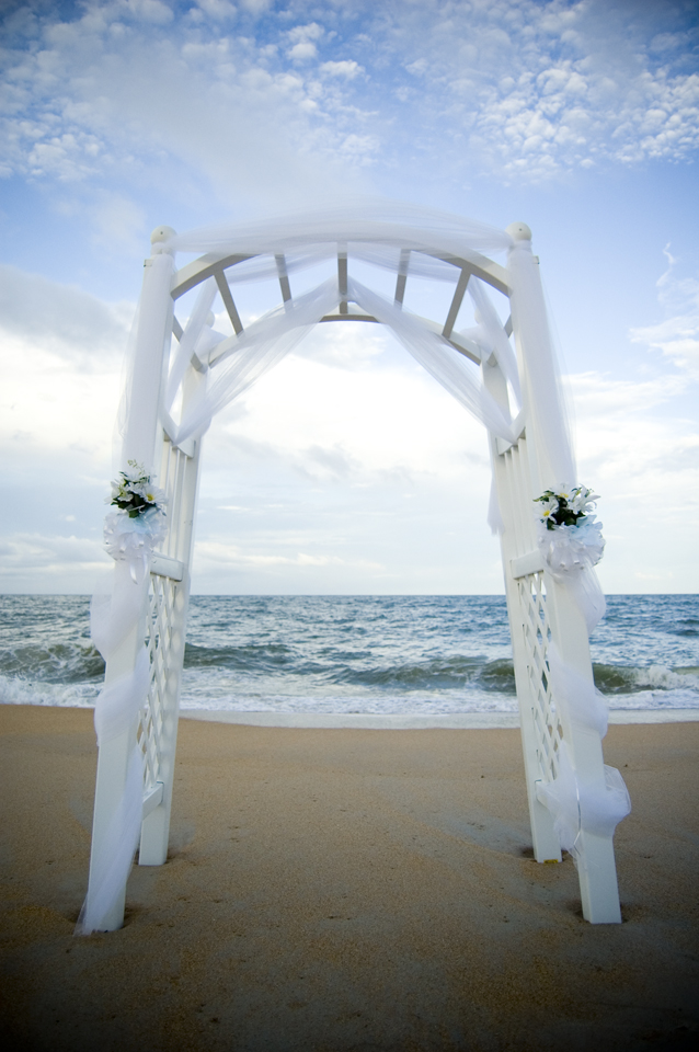 How can I decorate an arch for my wedding without using flowers or