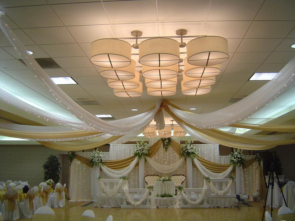 gold and white ceiling draping and backdrop